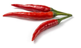 Red peppers. Red pepper, or cayenne pepper, helps burn calories faster, curbs hunger and adds a zesty flavor to low fat, low calorie foods Royalty Free Stock Images