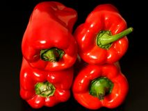 Red peppers on black background Royalty Free Stock Photos