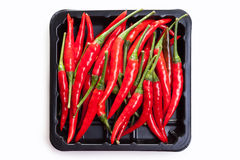 Red peppers on black background Royalty Free Stock Photo