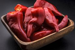 Red peppers in a bowl stock images