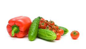 Red peppers, cherry tomatoes and cucumbers on a white background Royalty Free Stock Images