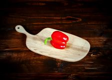 Red Peppers on dark chalkboard with copy-space stock photos