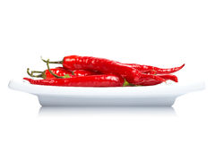 Red peppers in the dish Stock Photos