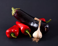 Red peppers, garlic and eggplants Royalty Free Stock Images