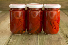Red peppers. In a glass jar Royalty Free Stock Photography