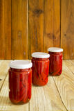 Red peppers. In a glass jar Stock Images