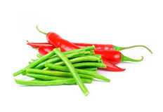 Red peppers with green beans Royalty Free Stock Photography