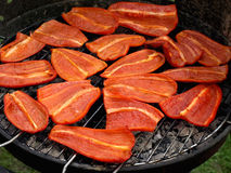 Red peppers. On the grill Stock Photos