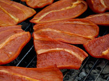 Red peppers. On the grill Stock Image
