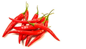Red peppers laying against a white Royalty Free Stock Images