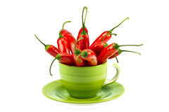 Red peppers in a mug Stock Photos