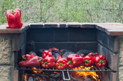 Red peppers roasting on the barbecue Royalty Free Stock Photography