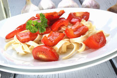 red peppers with tomato on pasta Stock Photo