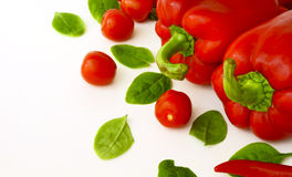 Red peppers and tomatoes. On a white background Royalty Free Stock Photo