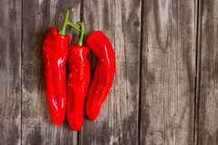 Red peppers on wood Royalty Free Stock Photos