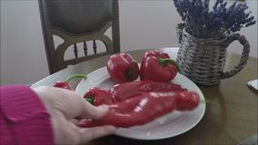 Red peppers on a wooden background stock footage
