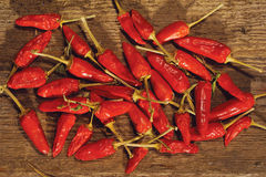Red Peppers on Wooden Table. A bunch of red peppers on wooden table royalty free stock photography