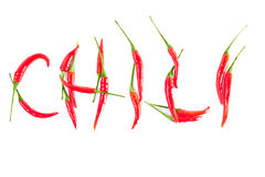 Red peppers in a word CHILI Stock Photography
