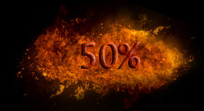 Red 50 percent % on fire flame explosion, black background Stock Image
