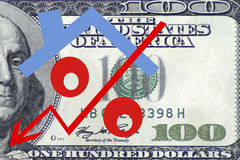 Red percent sign with arrow on the background of banknotes Royalty Free Stock Photos