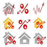 Red percent sign on the background of houses . Royalty Free Stock Photography