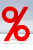 Red percentage icon on display in a store. Advertising markdowns and reductions in a seasonal sale Royalty Free Stock Photos