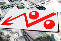 Red percentage symbol on the background of banknotes Royalty Free Stock Photos