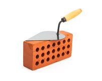 Red perforated ceramic brick and trowel isolated Stock Image