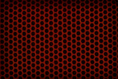 Red perforated plastic background Royalty Free Stock Photography