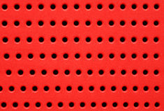 Red perforated plastic background Royalty Free Stock Photo
