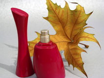 Red perfume and yellow lamina Stock Image