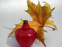 Red perfume and yellow lamina Stock Photography