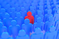 A red person in a crowd of blue people Stock Photos