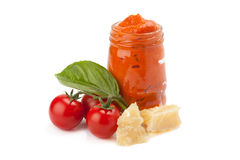 Red pesto in the glass with piece of cheese, cherry tomato and l Stock Photography