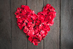 Red petal roses shaped like a heart on wood background,. Retro vintage ,Valentines Day stock photo