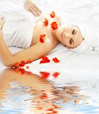 Red petals spa with water Royalty Free Stock Images