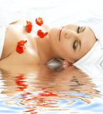Red petals spa with water  Stock Photo