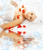 Red petals spa with water Stock Images