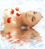 Red petals spa with water Royalty Free Stock Photography