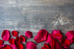 Red petals on wood Royalty Free Stock Photo