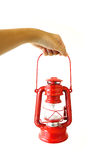 Red petrol lamp. Hand with red petrol lamp stock image