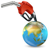 A red petrol pump and a globe Stock Photography