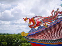 Red phoenix bird on the roof in Chinese temple. Red phoenix bird on top the roof in Chinese temple royalty free stock photography