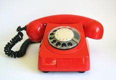 Red phone. One old, red telephone with white background Royalty Free Stock Images