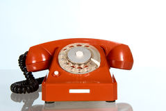 Red phone. Nice old-styled red telephone on white background Royalty Free Stock Photo