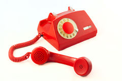 Red phone. Old red plastic phone on a white background Royalty Free Stock Images