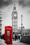 Red phone booth and Big Ben in London, England UK. Red telephone booth and Big Ben in London, England, the UK. People walking in rush. The symbols of London in Stock Images