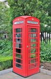 Red phone booth. A classic English phone booth in London Stock Photo