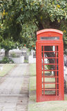 Red Phone Booth In Park