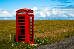 Red phone booth in landscape V1. Red phone booth standing alone in landscape Stock Image
